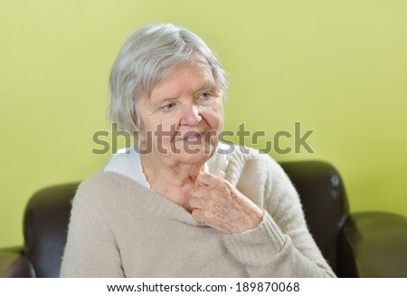 Senior worried woman with grey hairs. MANY OTHER PHOTOS WITH THIS MODEL IN MY PORTFOLIO. - stock photo