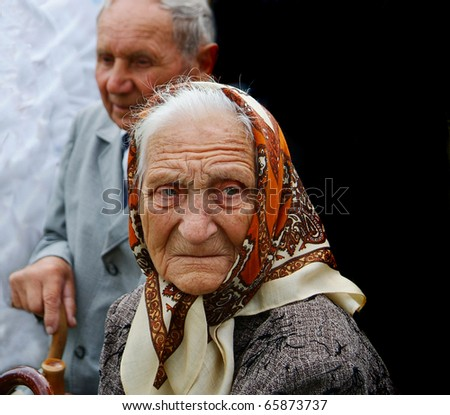 seniors  aged adults women grandmother grandfather ethnic uselessness estrangement - stock photo