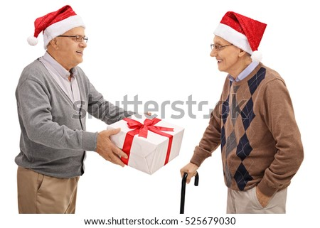 Seniors exchanging christmas presents isolated on white background