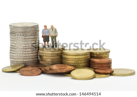 Seniors figurines with euro coins isolated on white background - stock photo