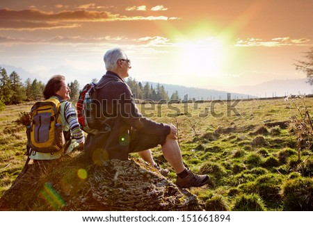 seniors hiking in nature on an autumn day - stock photo