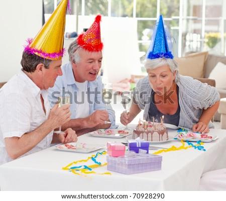 Seniors on birthday at home - stock photo