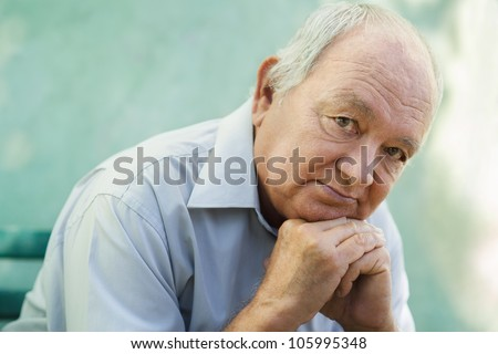 Seniors portrait of contemplative old caucasian man looking at camera. Copy space - stock photo