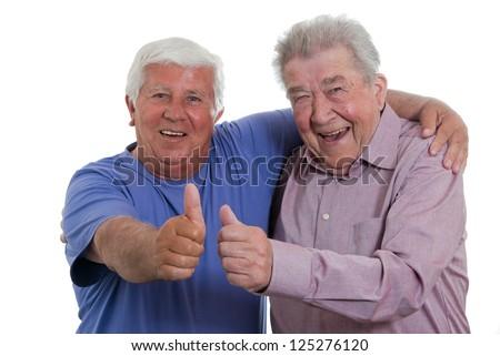 Seniors raise the thumb - stock photo