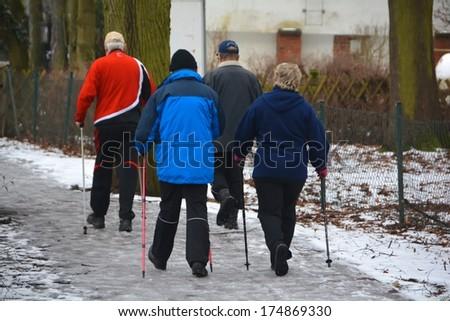 Seniors while hiking - stock photo