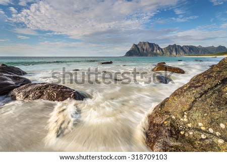 Senja, Norway. Uttakleiv beach at sunset, with big rocks on the foreground.