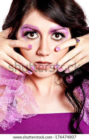 Sensual beautiful girl with violet shiny glitter make-up