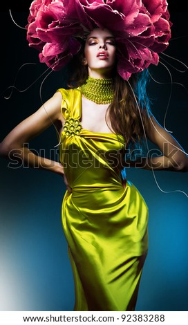 sensual beautiful woman in green dress and flower hat - stock photo