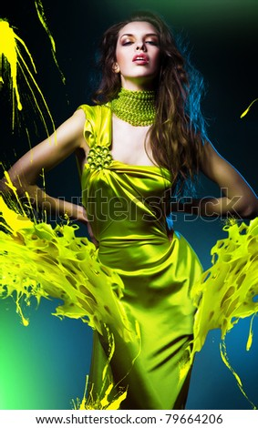 sensual beautiful woman in green dress and paint splash - stock photo