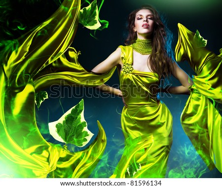 sensual beautiful woman in green fabric and leaves - stock photo