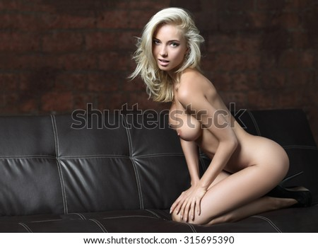 Sensual beautiful woman with perfect slim body posing naked, looking at camera. - stock photo
