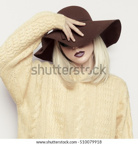 Sensual Blond in fashion Hat. Stylish Accessories of the season