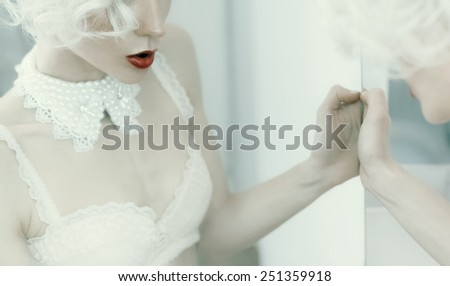 Sensual blond Woman. Reflection in the mirror. Necklace. Underwear. Luxury style. - stock photo