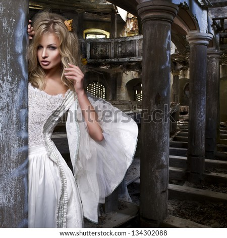 Sensual blonde woman in white dress - stock photo