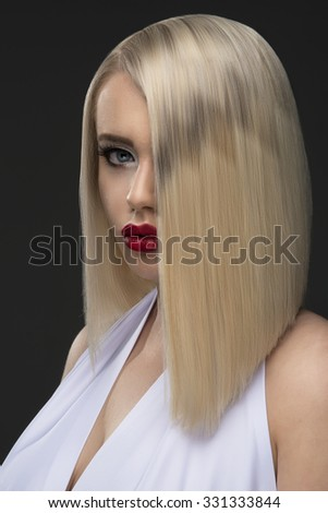 Sensual blonde woman with perfect body posing in studio, looking at camera  - stock photo