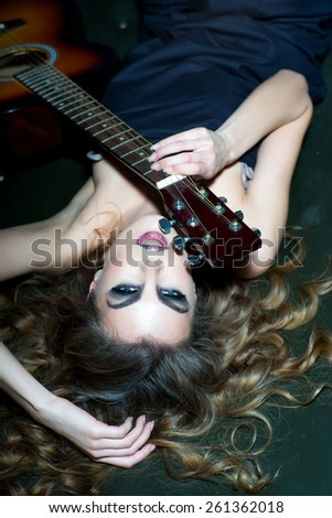 sensual blonde woman with shiny curly silky hair and guitar - stock photo