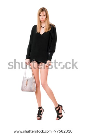Sensual blonde woman with the white purse - stock photo