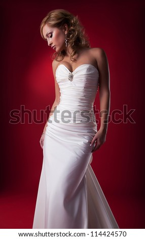 Sensual bride blonde in white bridal dress studio shot - series photo - stock photo