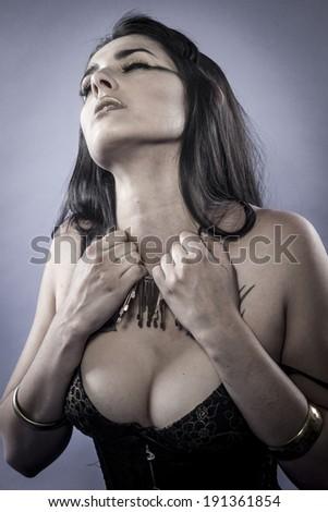 Sensual brunette dressed in black lingerie, studio shoot - stock photo