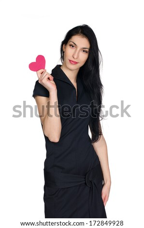 sensual brunette in black dress with  heart made �¢??�¢??of paper in hands isolated on white background