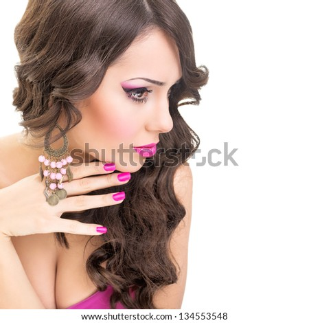 Sensual brunette in pink - stock photo