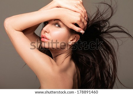 Sensual brunette with hair flying - stock photo