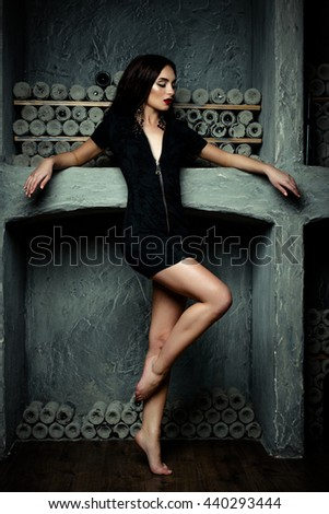 sensual brunette woman with perfect sexy black dress - stock photo