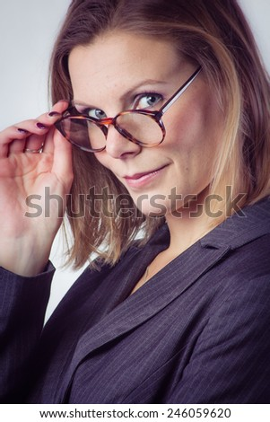 Sensual business woman with spectacles, isolated on white background