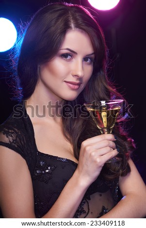Sensual celebrating woman with a cocktail - stock photo