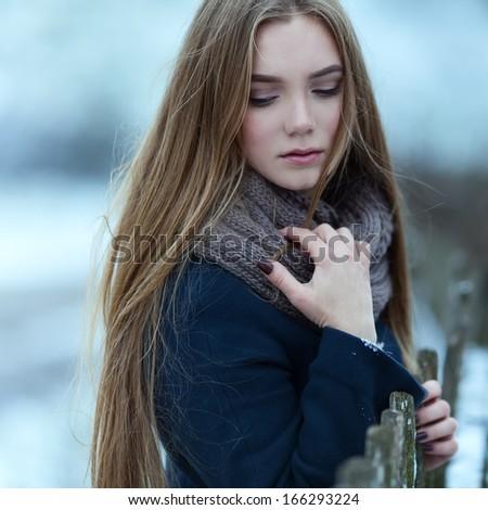 Sensual closeup portrait of beautiful girl in winter - stock photo
