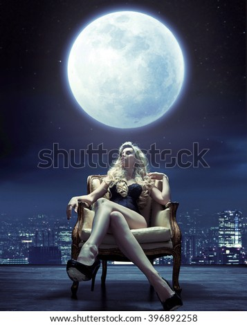 Sensual , confident blond woman on a armchair - stock photo