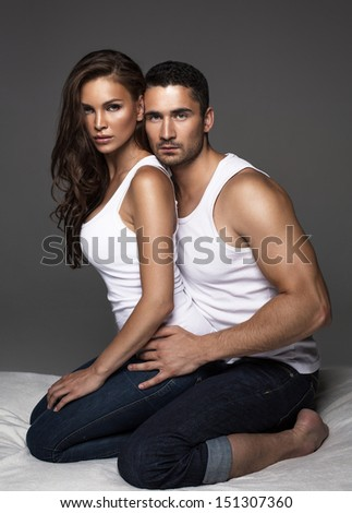 Sensual couple in bed - stock photo