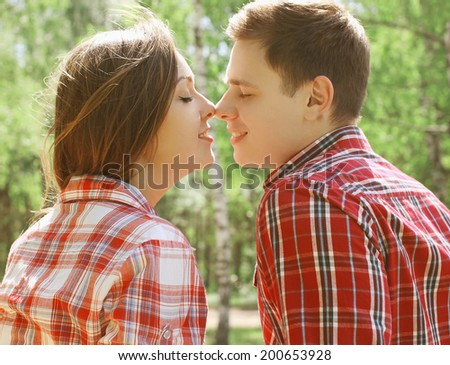 Sensual couple kissing in summer day - stock photo
