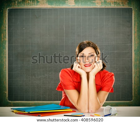 Sensual dreamy young student red dressed with glasses and blackboard
