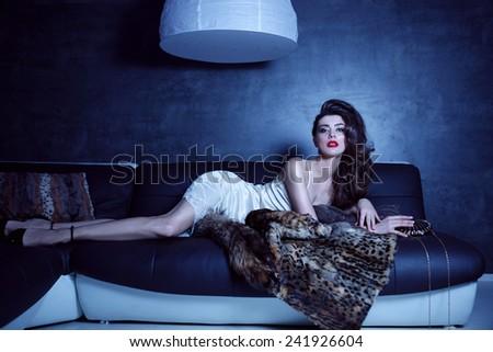 Sensual elegant young fashion woman, interior shot - stock photo