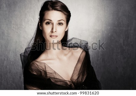 sensual elegant young nostalgic woman portrait desaturated colors studio shot