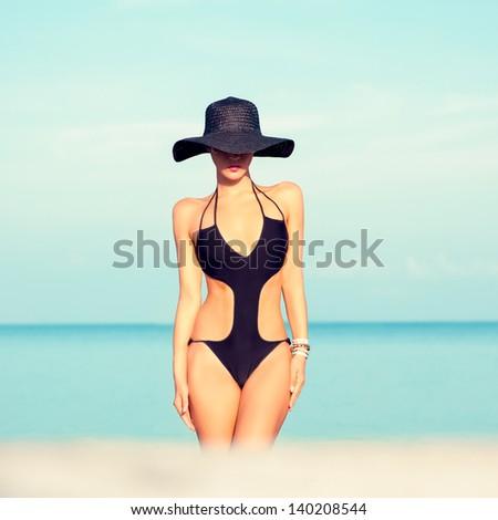sensual fashion girl on the beach - stock photo