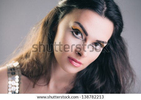 Sensual fashion portrait of young gorgeous woman in party dress
