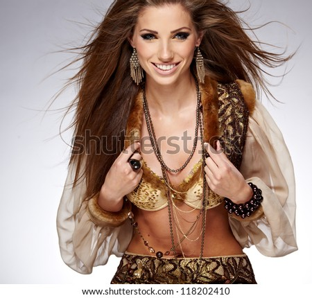 Sensual fashion woman with beautiful long brown hairs, posing isolated on grey - stock photo