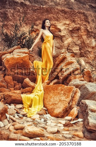 sensual girl on the rocks - stock photo