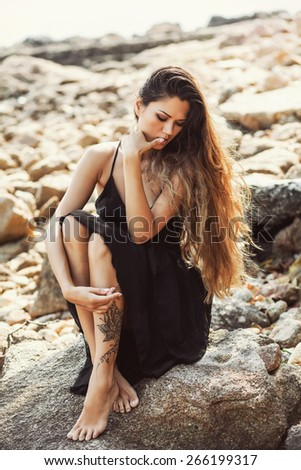 sensual girl sitting on the beach
