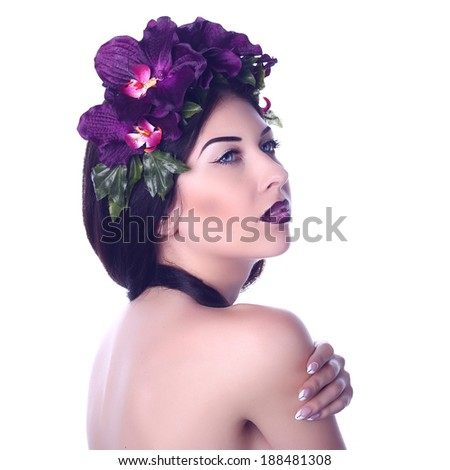sensual girl with makeup in a wreath of purple orchids