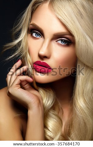 sensual glamour portrait of beautiful blond woman model lady with bright makeup and pink lips , with healthy curly hair on black background - stock photo