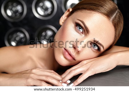 sensual glamour portrait of beautiful woman model lady with fresh daily makeup with pink lips color and clean healthy skin face on studio lights background