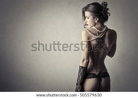 Sensual lady wearing pearls