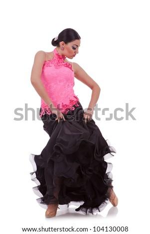 sensual latino dancer pulling up her  dress on white background - stock photo