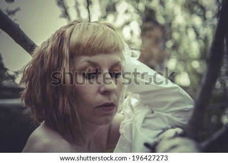sensual naked woman with white shirt in a forest of poplars