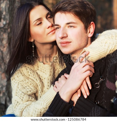 Sensual outdoor portrait of young couple in love - stock photo