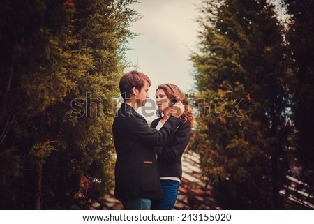 Sensual outdoor portrait of young fashion couple