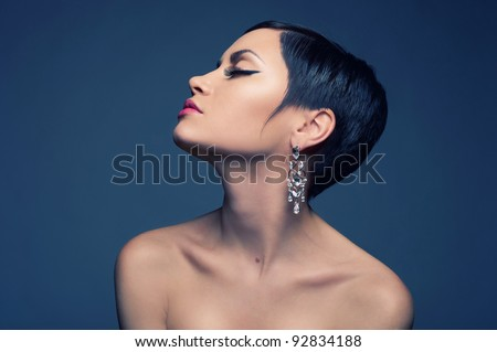 Sensual portrait of a beautiful lady with diamond earring - stock photo